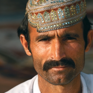An Afghan carpet seller